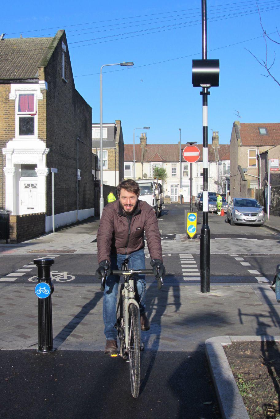 Man cycling towards camera