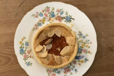 wild goose bakery blood orange and almond tart on a plate