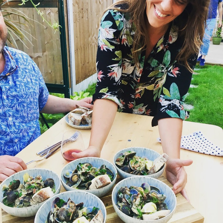 Chef Sarah Miller serves up bowls of muscles and bread