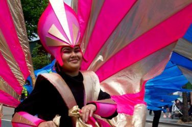 Pink winged performer at Leyton Carnival